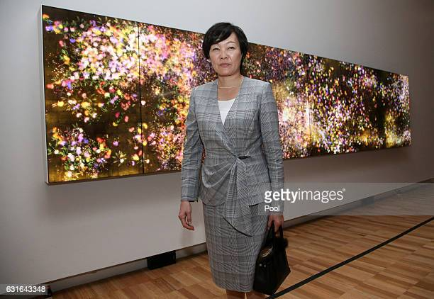 Akie Abe wife of Japanese Prime Minister Shinzo Abe walks past an installation from a Japanese artist while visiting the Art Gallery of New South...