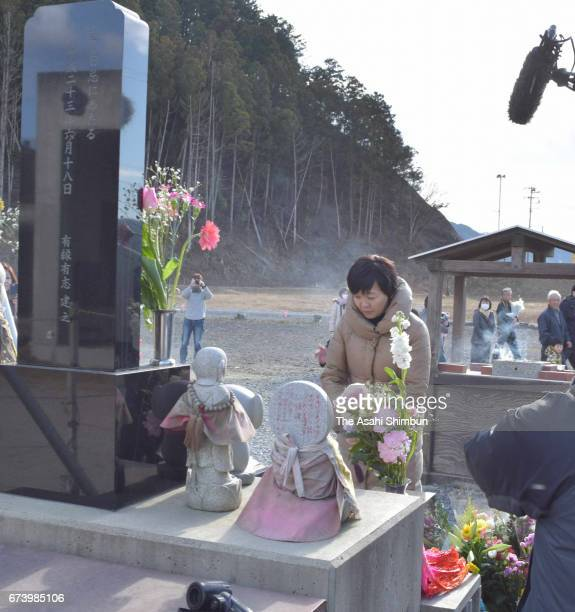 Akie Abe wife of Prime Minister Shinzo Abe prays for the victims at a memorial ceremony on the sixth anniversary of the Great East Japan Earthquake...