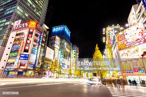 Akihabara Electric Town at night with car light trails at street