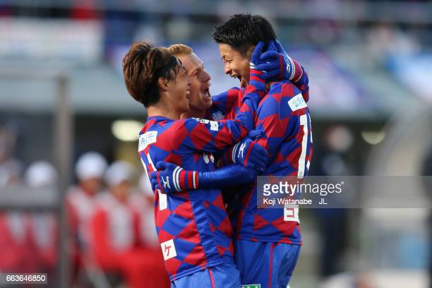 Akihiro Hyodo of Ventforet Kofu celebrates scoring the opening goal with his team mates Yuki Horigome and Oliver Bozanic during the JLeague J1 match...
