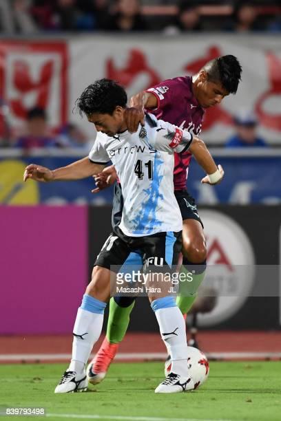 Akihiro Ienaga of Kawasaki Frontale and Eder Lima of Ventforet Kofu compete for the ball during the JLeague J1 match between Ventforet Kofu and...