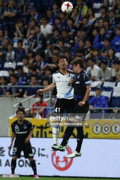 Akihiro Ienaga of Kawasaki Frontale and Genta Miura of Gamba Osaka compete for the ball during the JLeague J1 match between Gamba Osaka and Kawasaki...