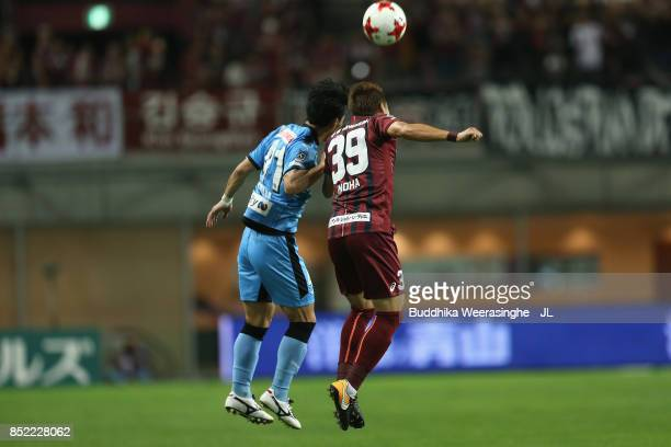 Akihiro Ienaga of Kawasaki Frontale and Masahiko Inoha of Vissel Kobe compete for the ball during the JLeague J1 match between Vissel Kobe and...