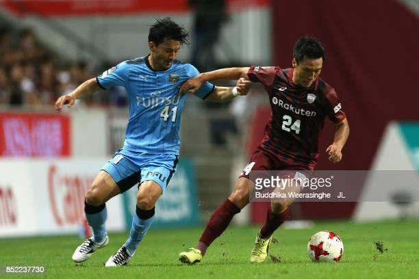Akihiro Ienaga of Kawasaki Frontale and Masatoshi Mihara of Vissel Kobe compete for the ball during the JLeague J1 match between Vissel Kobe and...