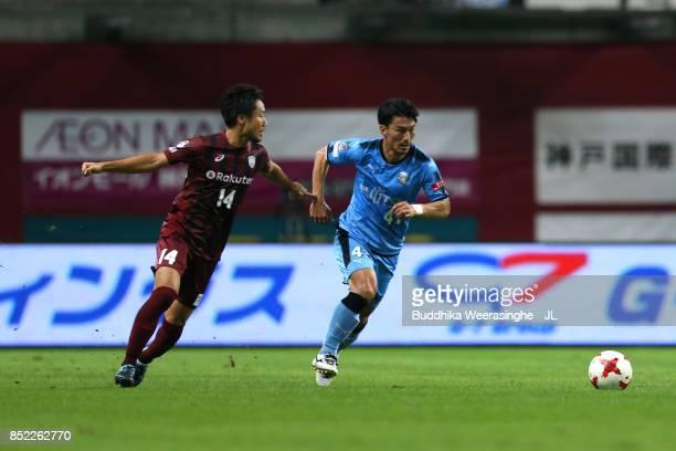 Akihiro Ienaga of Kawasaki Frontale and Naoyuki Fujita of Vissel Kobe compete for the ball during the JLeague J1 match between Vissel Kobe and...