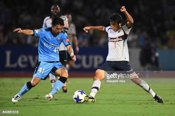 Akihiro Ienaga of Kawasaki Frontale and Takuji Yonemoto of FC Tokyo and compete for the ball during the JLeague Levain Cup quarter final first leg...