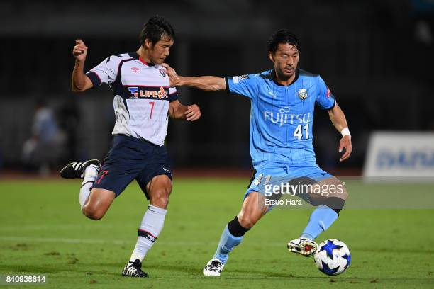 Akihiro Ienaga of Kawasaki Frontale and Takuji Yonemoto of FC Tokyo compete for the ball during the JLeague Levain Cup quarter final first leg match...