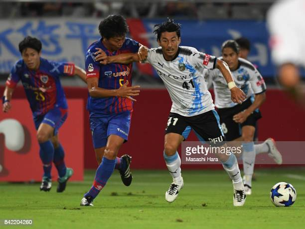 Akihiro Ienaga of Kawasaki Frontale and Yuichi Maruyama of FC Tokyo compete for the ball during the JLeague Levain Cup quarter final second leg match...