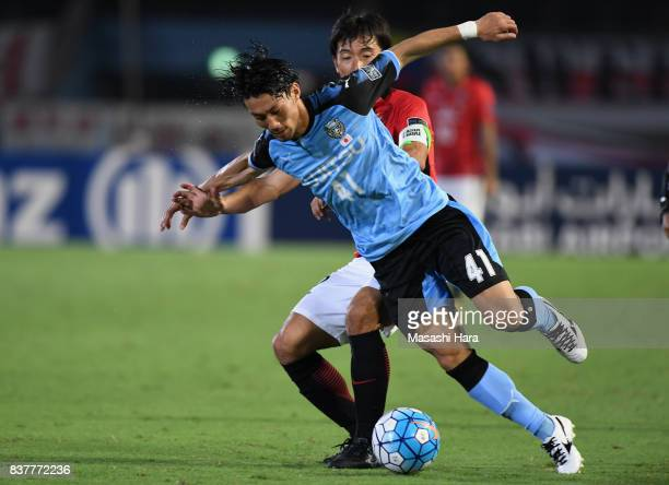 Akihiro Ienaga of Kawasaki Frontale and Yuki Abe of Urawa Red Diamonds compete for the ball during the AFC Champions League quarter final first leg...