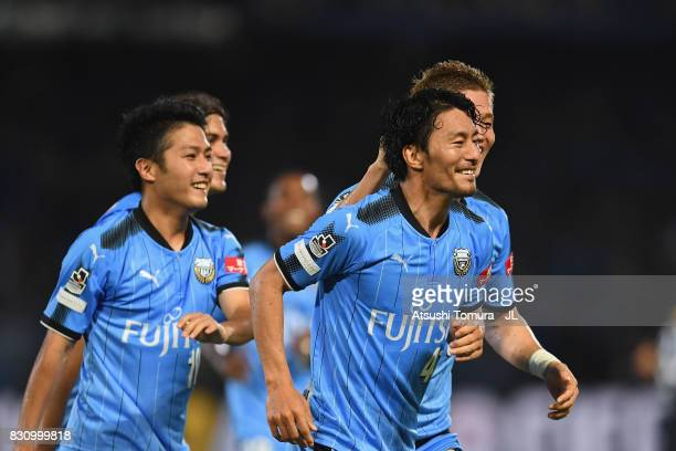 Akihiro Ienaga of Kawasaki Frontale celebrates scoring his side's first goal with his team mate during the JLeague J1 match between Kawasaki Frontale...