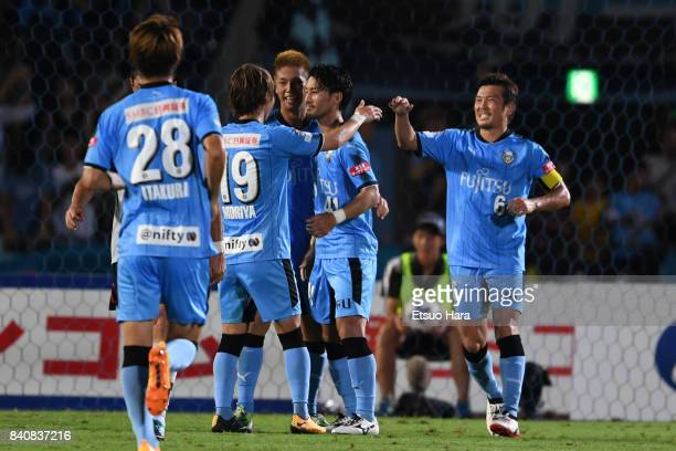 Akihiro Ienaga of Kawasaki Frontale celebrates scoring his side's first goal with his team mates during the JLeague Levain Cup quarter final first...