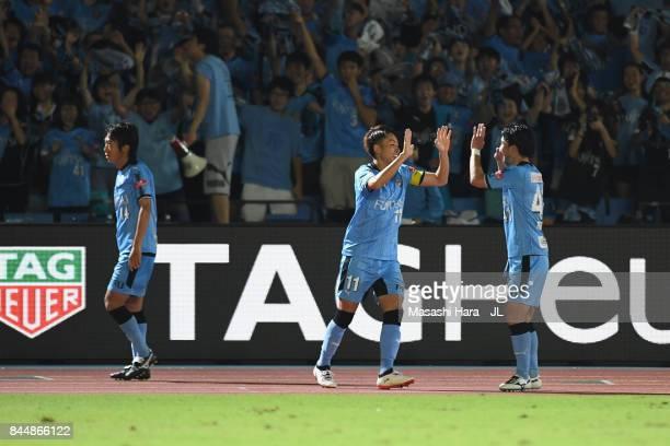 Akihiro Ienaga of Kawasaki Frontale celebrates scoring his side's third goal with his team mate Yu Kobayashi during the JLeague J1 match between...