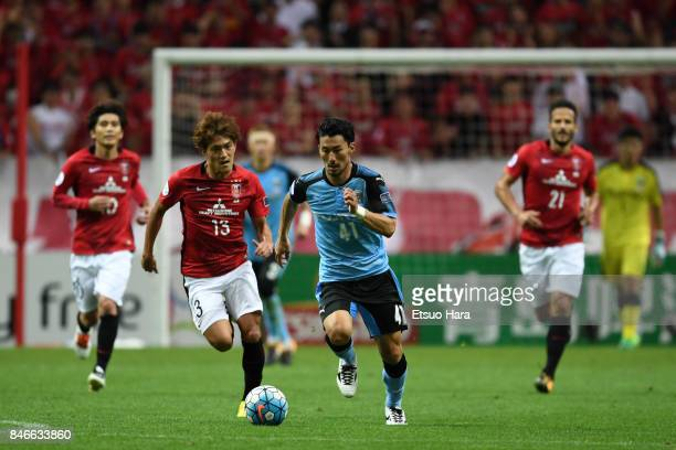 Akihiro Ienaga of Kawasaki Frontale controls the ball during the AFC Champions League quarter final second leg match between Urawa Red Diamonds and...