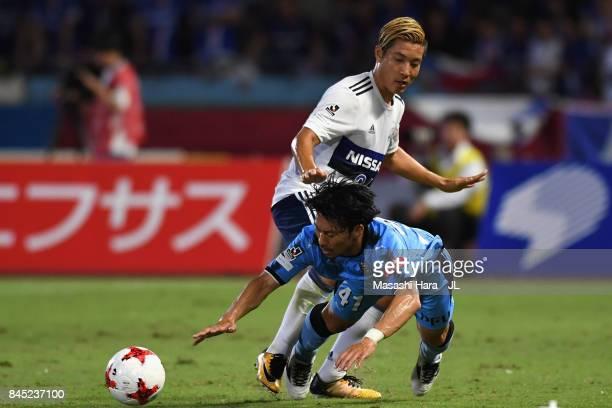 Akihiro Ienaga of Kawasaki Frontale is challenged by Ryosuke Yamanaka of Yokohama FMarinos during the JLeague J1 match between Kawasaki Frontale and...
