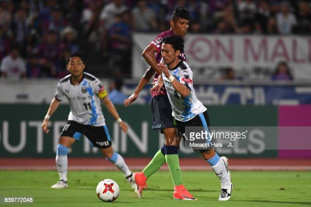 Akihiro Ienaga of Kawasaki Frontale is fouled by Eder Lima of Ventforet Kofu resulting in the penalty kick during the JLeague J1 match between...