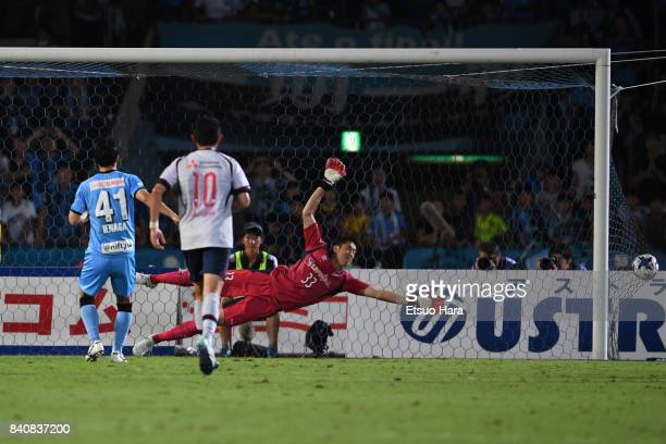 Akihiro Ienaga of Kawasaki Frontale scores his side's first goal with his team mates during the JLeague Levain Cup quarter final first leg match...