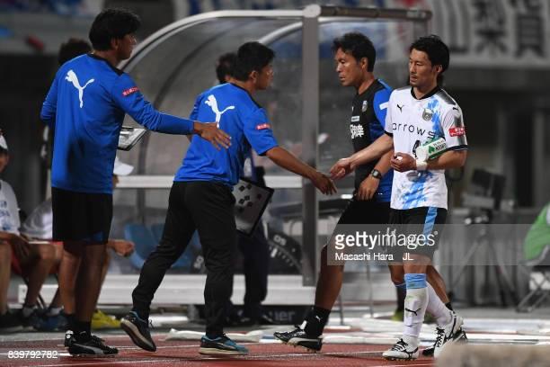 Akihiro Ienaga of Kawasaki Frontale shakes hands with team staffs after substituted during the JLeague J1 match between Ventforet Kofu and Kawasaki...