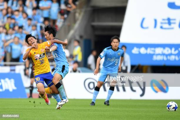 Akihiro Ienaga of Kawasaki Frontale tackelsTakuma Nishimura of Vegalta Sendai during the JLeague Levain Cup semi final second leg match between...
