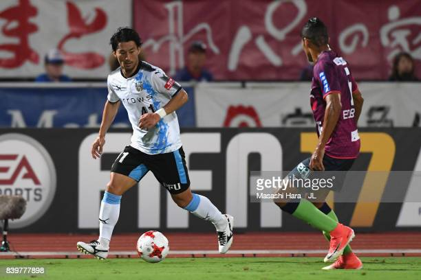 Akihiro Ienaga of Kawasaki Frontale takes on Eder Lima of Ventforet Kofu during the JLeague J1 match between Ventforet Kofu and Kawasaki Frontale at...