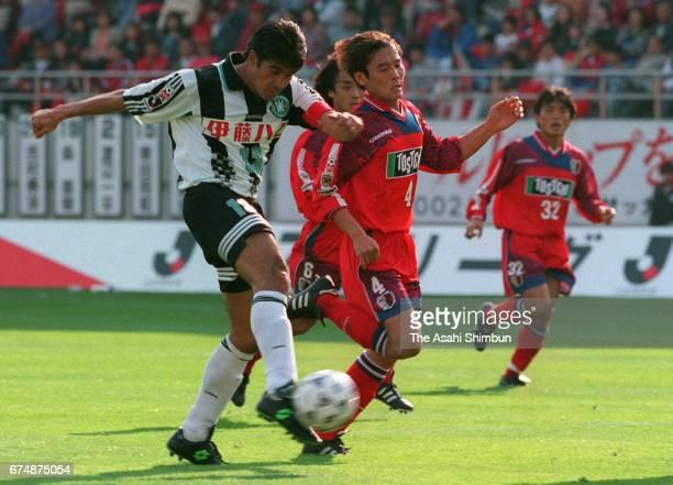 Akihiro Nagashima of Vissel Kobe scores his side's second goal during the JLeague match between Kashima Antlers and Vissel Kobe at Kashima Soccer...