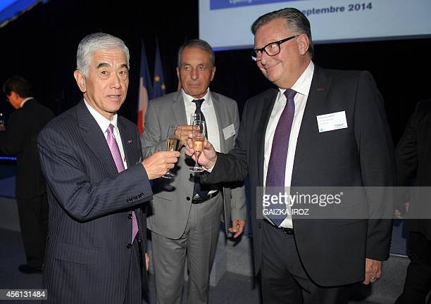 Akihiro Nikkaku president of Tokyobased carbon fiber producer Toray Industries makes a toast with Jacques CassiauHaurie president of LacqOrthez...