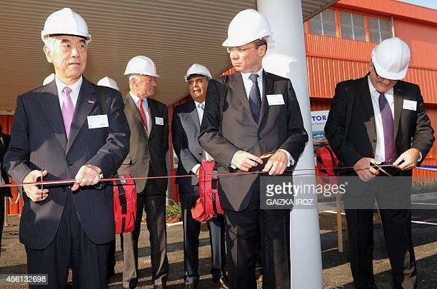 Akihiro Nikkaku president of Tokyobased carbon fiber producer Toray Industries PyreneesAtlantiques prefect Pierre AndreDurand and Bernard Martin...