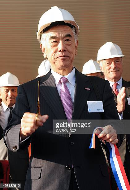 Akihiro Nikkaku president of Tokyobased carbon fiber producer Toray Industries cuts the ribbon during the inauguration of a new Toray Industries...
