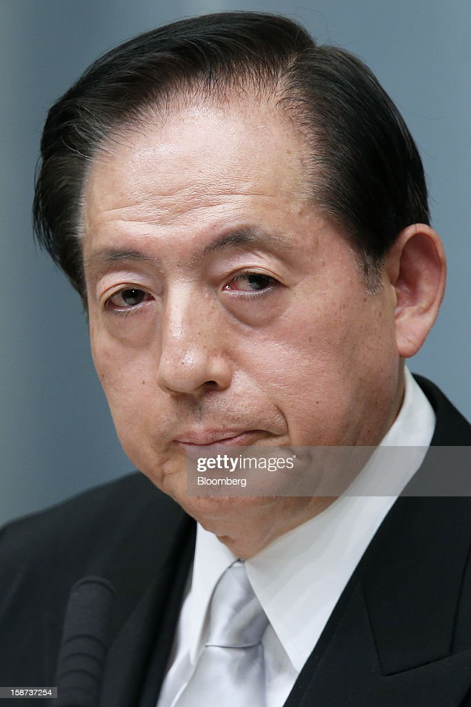 Akihiro Ohta, Japan's newly appointed minister of land, infrastructure, and transport, pauses during a news conference at the prime minister's official residence in Tokyo, Japan, on Thursday, Dec. 27, 2012. Japan's parliament confirmed Shinzo Abe as the nation's seventh prime minister in six years, returning him to the office he left in 2007 after his party regained power in a landslide election victory last week. Photographer: Kiyoshi Ota/Bloomberg via Getty Images