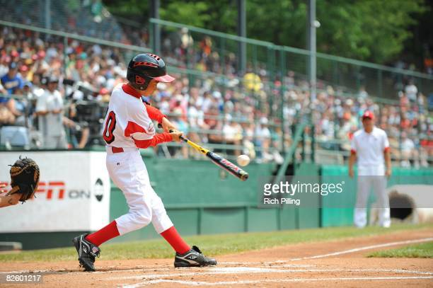 Akihiro Takeuchi of the Edogawa Minami Little League team from Tokyo Japan bats against the Matamoros Little League team from Matamoros Mexico during...