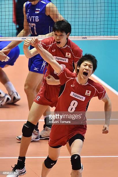 Akihiro Yamauchi and Yuki Ishikawa of Japan celebrate after winning a point during the FIVB Men's Volleyball World Cup Japan 2015 at Yoyogi National...