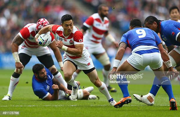Akihito Yamada of Japan breaks during the 2015 Rugby World Cup Pool B match between Samoa and Japan at Stadium mk on October 3 2015 in Milton Keynes...