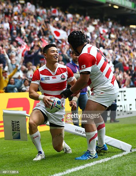 Akihito Yamada of Japan celebrates scoring his teams second try with Kensuke Hatakeyama during the 2015 Rugby World Cup Pool B match between Samoa...