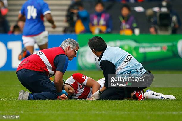 Akihito Yamada of Japan receives treatment during the 2015 Rugby World Cup Pool B match between Samoa and Japan at Stadium mk on October 3 2015 in...