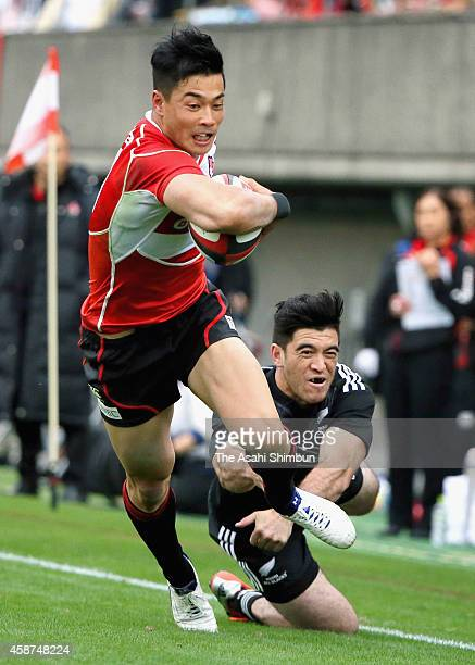 Akihito Yamada of Japan runs with the ball to score a try during the international friendly match between Maori All Blacks and Japan at the Prince...