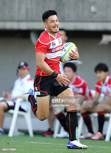 Akihito Yamada of Japan runs with the ball to score a try during the Asia Rugby Championship match between Japan and Hong Kong at Prince Chichibu...