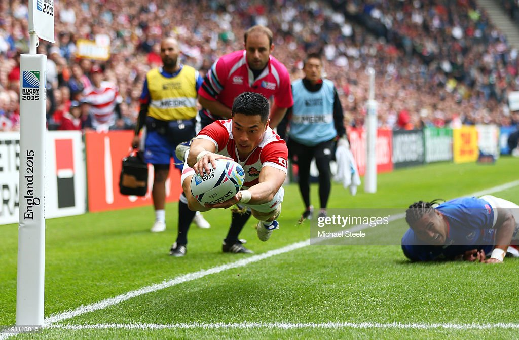 Akihito Yamada of Japan scores his teams second try during the 2015 Rugby World Cup Pool B match between Samoa and Japan at Stadium mk on October 3...