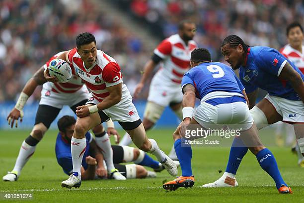 Akihito Yamada of Japan sidesteps as Kahn Fotuali'l of Samoa closes in during the 2015 Rugby World Cup Pool B match between Samoa and Japan at...