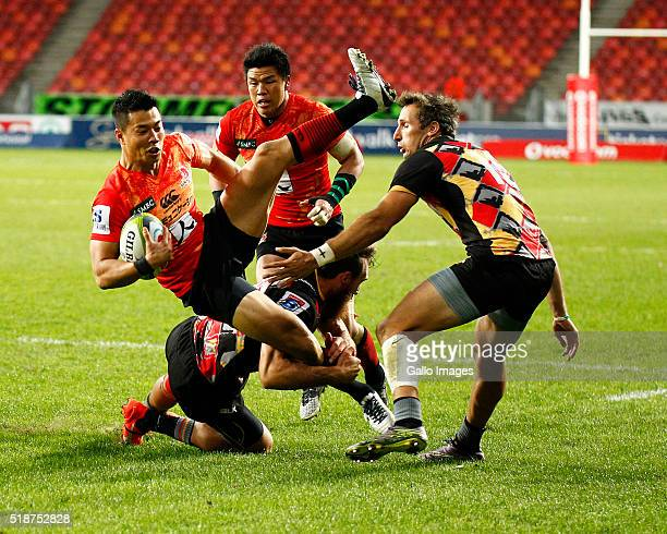 Akihito Yamada of the Sun Wolves is tackled by Jaco van Tonder of the Southern Kings during the 2016 Super Rugby match between Southern Kings and...