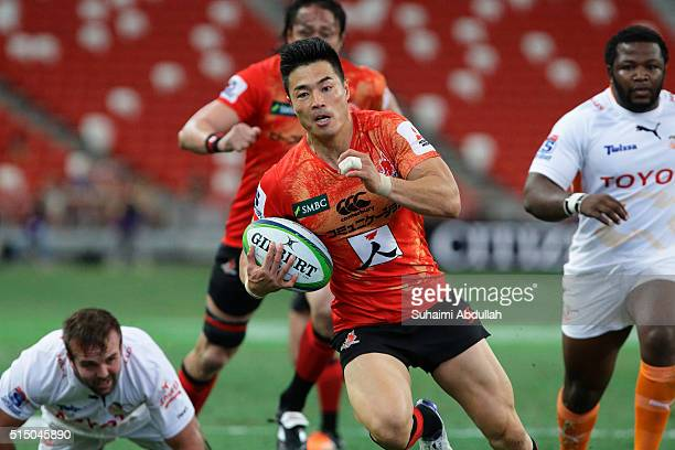 Akihito Yamada of the Sunwolves runs with the ball and scores a try during the round three Super Rugby match between the Japan Sunwolves and the...