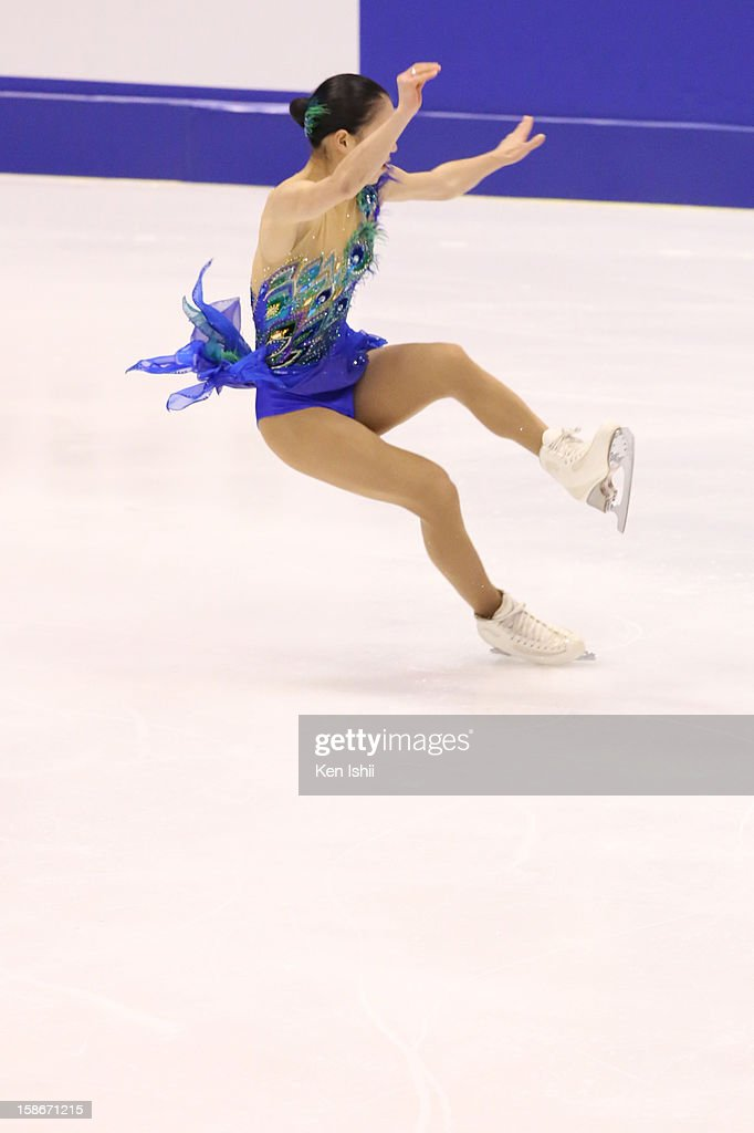Akiko Suzuki falls in the Women's Free Program during day three of the 81st Japan Figure Skating Championships at Makomanai Sekisui Heim Ice Arena on December 23, 2012 in Sapporo, Japan.