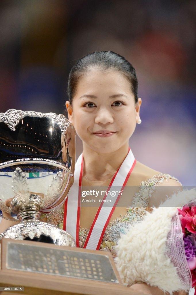 Akiko Suzuki of Japan poses in the victory ceremony during All Japan Figure Skating Championships at Saitama Super Arena on December 23, 2013 in Saitama, Japan.