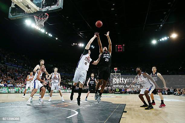 Akil Mitchell of New Zealand competes for the rebound against Cameron Bairstow of Brisbane during the round five NBL match between the New Zealand...