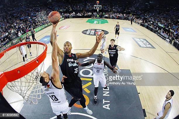 Akil Mitchell of New Zealand goes to the basket against David Anderson of Melbourne during the round one NBL match between the New Zealand Breakers...