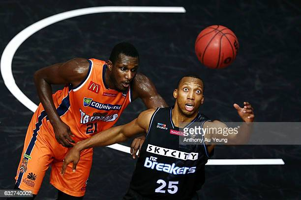Akil Mitchell of the Breakers looks to catch a pass against Nnanna Egwu of the Taipans during the round 17 NBL match between the New Zealand Breakers...