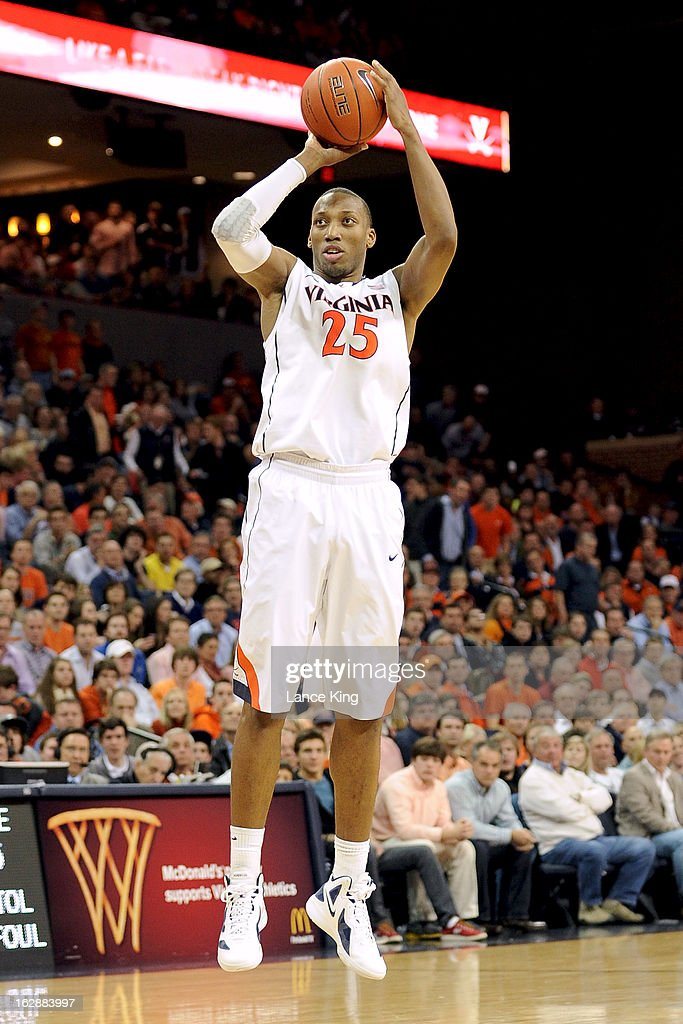 Akil Mitchell #25 of the Virginia Cavaliers puts up a shot against the Duke Blue Devils at John Paul Jones Arena on February 28, 2013 in Charlottesville, Virginia. Virginia defeated Duke 73-68.