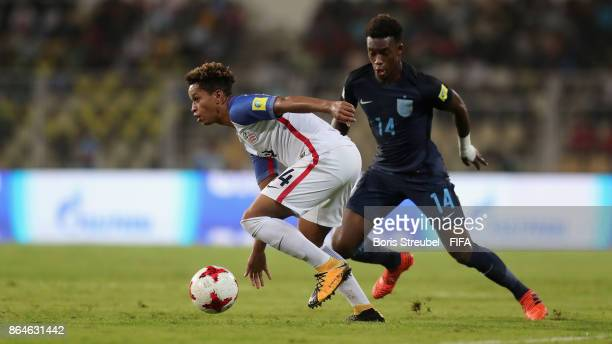 Akil Watts of the United States battles for the ball with Callum HudsonOdoi of England during the FIFA U17 World Cup India 2017 Quarter Final match...