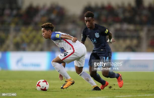 Akil Watts of the United States is challenged by Callum HudsonOdoi of England during the FIFA U17 World Cup India 2017 Quarter Final match between...