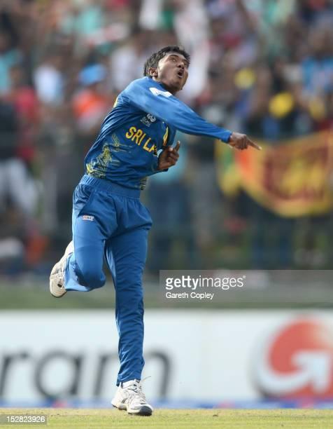 Akila Dananjaya of Sri Lanka celebrates dismissing Martin Guptil of New Zealand during the ICC World Twenty20 2012 Super Eights Group 1 match between...