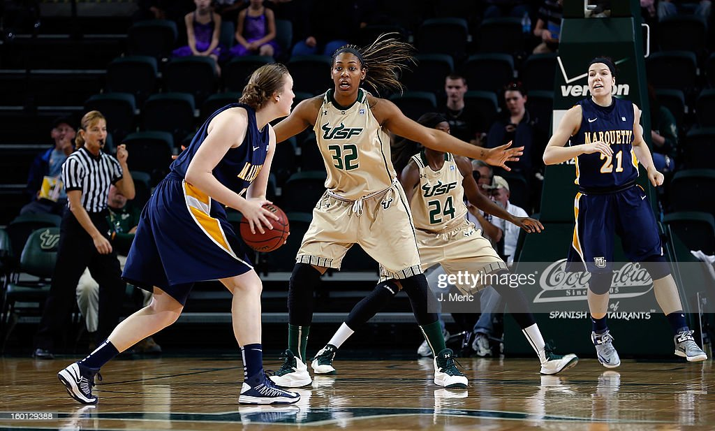 Akila McDonald #32 of the South Florida Bulls defends Lauren Tibbs #32 of the Marquette Golden Eagles during the game at the Sun Dome on January 26, 2013 in Tampa, Florida.
