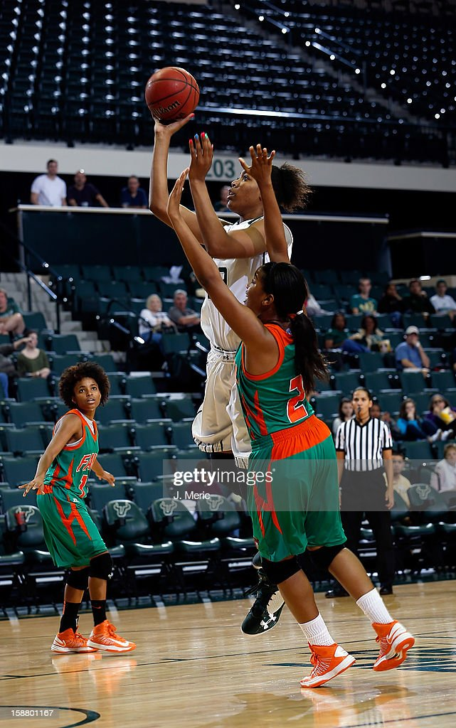 Akila McDonald #32 of the South Florida Bulls shoots as Keturah Martin #23 of the Florida A&M Rattlers defends during the game at the Sun Dome on December 29, 2012 in Tampa, Florida.